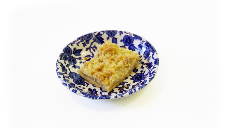 piece of cake on a small blue and white plate
